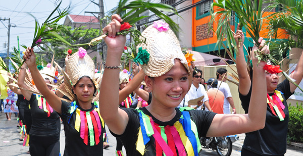 Barangay Mabolo in Valenzuela City celebrates the feast day of its patron saint San Roque, May 12, 2012 with street dancing. It is believed that devout singles who pray and dance in honor of San Roque will be blessed to find their life's partner. PHOTO BY MARK CAYABYAB